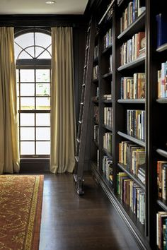 charcoal bookshelves with library ladder