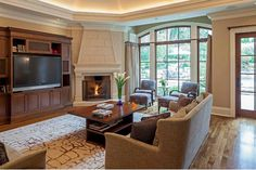 Corner fireplace with ordinary ceiling height in family room, backyard views. Skip the builtin or large hutch for TV.