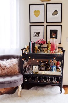 My bar cart was the best spot to try the new trend in picture frame galleries! Create a grid of picture frames! It adds a modern touch. These pink accessories for the bar cart are from HomeGoods and add the perfect pop of color! All refreshed for the new year. Sponsored by HomeGoods