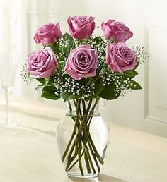 Love's Embrace™ Roses - Purple Put the crowning touch on their day with a gift of purple roses. Beautifully hand-arranged by our select florists, they make a sparkling and sophisticated expression of