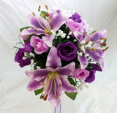 Purple Tiger lillies, ivory but no purple roses ... I like this but only if there were alot more white roses not purple