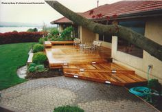 A brand new deck was put in for this home exterior. The deck received quite the refinishing job. On top of that, the view of the lake adds to the exterior, taking away the ugly look of the tree in back.