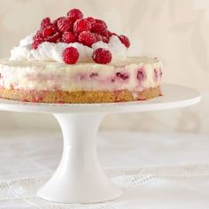 A smooth and deliciously creamy white chocolate no bake cheesecake with raspberries and a buttery granita base. Fairy floss optional.