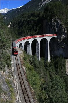Landwasser limestone railway viaduct built between 1901 and 1902 for the Rhaetian Railway - It is 65 metres high, 136 metres long, and one of its ramps exits straight into the Landwasser Tunnel - GR - Switzerland