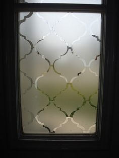 """frosted"" windows with contact paper: great idea for the windows next to my front door - a little privacy without sacrificing the natural light.  would also be cool to do on large pic frame/partition"