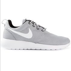 Nike Rosche Runs Stylish and extremely comfortable. Great for gyming, outdoors and casual wear. The inside padded with cushioning that makes it a great runner! Brought originally from store, minor tear on the left shoe, however comes in Nike box. Nike Shoes