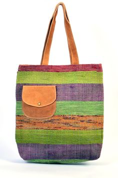 #styleincraft  #buyhandbagsonline #handmadehandbag  Handmade Carpet Style Leather Pocket Handbag. All the elements which go into making a quality product is monitored right from the first stage of leather selection to finishing of the carpet  fabric product at their manufacturing facility. An multicolor shaded design,valuable small pocket, and a dura