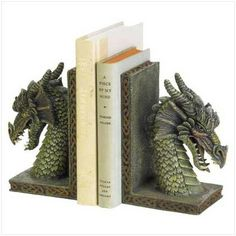 DSHD Fierce Dragon Book Ends  Fierce dragon book ends create mystical flair in any room. Your most treasured tomes will remain upright with these mythical dragon guardians! Heavy polyresin.