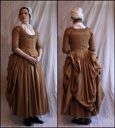 1770 dress with pleated trim around neck and sleeves. back of the gown is up in the Polonaise style that was prominent.
