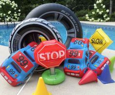 Inflatable tires, cars and traffic signs means there is a lot of racing going on in this swimming pool.