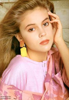"""Ariel's appearance and personality was largely based on actress Alyssa Milano, who was then a child star on """"Who's the Boss?"""". We definitely see the resemblance in her parted hair and bright eyes -- and no one was cuter than Milano back in 1989!"""