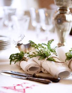 Use a sprig of evergreen to tie together napkins and silverware