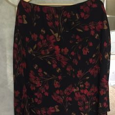 Beautiful skirt Black sheer material with flowers and little beads that outline some of the flowers. Fully lined. Ruffled bottom. Never worn. 100 percent polyester as well as the lining . JM Collection Skirts