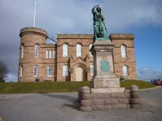 Inverness castle & Statue of Flora Macdonald, the lady who helped smuggle Bonnie Prince Charlie out of Scotland after Culloden.