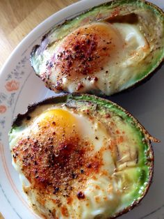 BAKED EGG IN AVOCADO #GlutenFree : Preheat oven to 425, have cast iron pan in there Slice avocado in half, take out pit take pan out, put avocado half on, crack egg in put whatever you want on top place in oven and cook till your eggs 15 to 20 minutes.