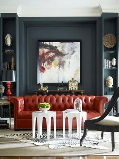 LIVING ROOM / MILL WORK / DARK WALLS / TUFTED LEATHER SOFA
