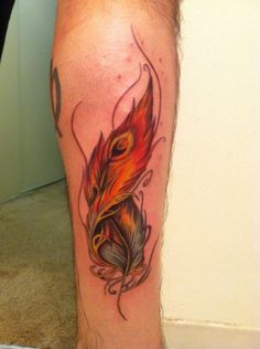 my favorite Phoenix Feather Tattoo so far! LOVE how it twists and the various colors on it!