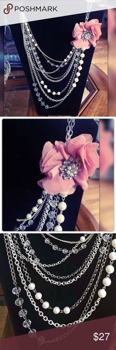 Multi-Strand Crystal Pearl Rose Necklace Beautiful and elegant doubles multi strand braid a necklace with crystals and pearl accents and a removable flower brooch with rhinestones in crested in the middle. Never used in excellent condition Jewelry Necklaces