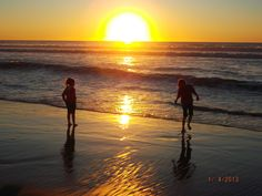 A picture of the sunset and two adorable little girls at the beach :)
