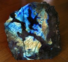 Labradorite - This mineral is so unique because it's not in crystal form but rather it's a chunky rock with a gorgeous iridescent face. Inside the mineral are fractures that cause it to reflect light back and forth, revealing a metallic glow of many colors.