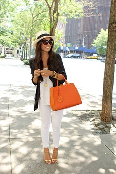 White skinny jeans, white top, dark blazer, Panama hat, orange handbag
