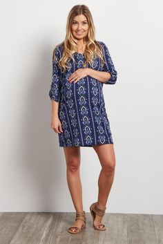 We fell in love with this maternity dress the moment we laid eyes on it! A gorgeous print and 3/4 sleeves make this a staple piece you can easily dress up or down for any occasion. Style this dress with wedges and a statement necklace for a perfect date night look.