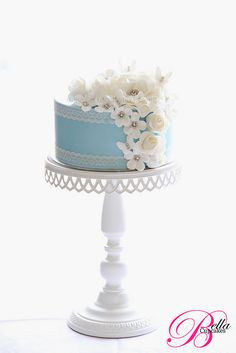 pretty little blue & white cake - would be cute in pink for a little girl's first birthday - love the tall cake stand