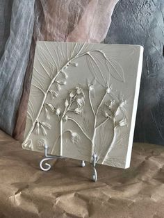Flowers & plants clay wall relief by DinaArtDecor. Square botanical bas relief on stand. Farmhouse plaster tile for kitchen, hallway and mantel decorating. Flowers & plants botanical bas-relief for wall and table decor. The botanical panel is ideal for decorating the entrance hall, living room, kitchen, bedroom or baby room #vintagewallart #woodart #kitchenwalldecor