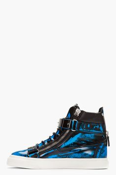 GIUSEPPE ZANOTTI //  Blue Brushed Leather Zippered High-Top Sneakers  32266M050004  High-top leather sneakers in black with brushed effect in blue throughout. Round toe. Black lace up closure. Tonal leather logo patch at tongue. Signature foldover velcro straps with metal bar detail at shoe face. Signature zip closures at eyerow and heel. Padded collar. Off-white rubber foxing. Tonal stitching. Leather upper, rubber sole. Made in Italy.  $1150 CAD