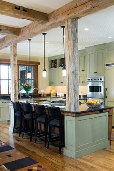 Craftsman Kitchen with Undermount sink, L-shaped, Linon Torino Bar Stool, Soapstone counters, Exposed beam, Soapstone