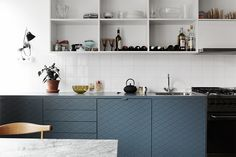 Something different. Open wall units and gray doors. // RIAZZOLI.: kitchen.