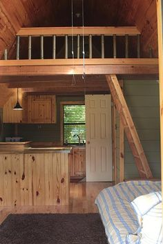Vlad's Tiny House - a 12 x 24 ft. building with a loft, front porch and two permanent overhangs that are used as a cook out area on one side and a place to park on the other. The little house has a stunning view of the valley below it. Tennessee (pinned by haw-creek.com)