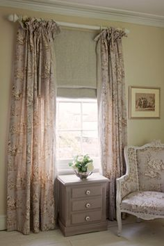 "chair and curtains in ""Normandie"" toile which depicts country scenes on dusty greyed lilac cotton that is double width.  Perfect to be used on walls too as is often seen here in France.  Chalk Paint™ colours Paloma and Emile go beautifully with this fabric."