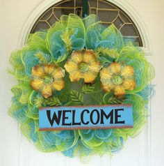 "Spring & Summer Welcome deco mesh wreath made with turquoise & green mesh. Yellow flowers has sparkle netting on the petals with a turquoise Welcome sign. ""My Wreath Creations"" by Sherry Ballew"