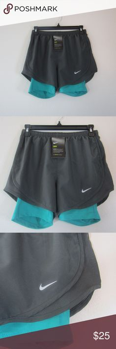 NWT NIKE DRI-FIT Women's Shorts Grey & Green NWT NIKE DRI-FIT Women's Shorts Running Exercise Work Out Grey and Green  Size X-Small. Interior pocket!  100% Polyester  Contact me if you have questions. :) Nike Shorts