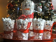 Creative Kid Snacks: Snowman Popcorn Cups  This would be adorable for a winter snack!