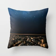 Throw Pillow made from 100% spun polyester poplin fabric. beach, sea, ocean, water, summer, night, sky, stars, blue, waves, horizon, landscape, nature, photo, photography, photographer, xiari, xiarim, dark, tapestry, art, print, wall art, home decor, decoration, decoracao, wall decor, duvet cover, pillow, rocks, peebles, white, sand, sea shore, space, milky way