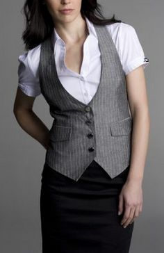 Change that white blouse for something colorful and you might get an interesting spin on this suit vest with a skirt!