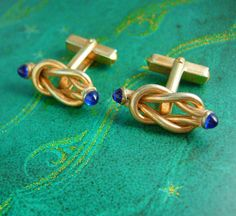 Beautiful blue jeweled ended love knot cufflinks that would compliment any wedding attire for an eternity ever lasting symbolic cuff jewelry or
