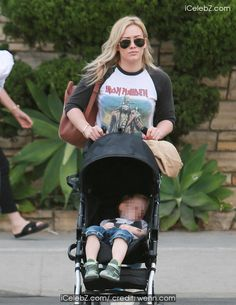 Heavy metal mom Hilary Duff is seen wearing an Iron Maiden raglan shirt as she pushes her son Luca in a Stroller in Beverly Hills http://www.icelebz.com/events/heavy_metal_mom_hilary_duff_is_seen_wearing_an_iron_maiden_raglan_shirt_as_she_pushes_her_son_luca_in_a_stroller_in_beverly_hills/photo3.html