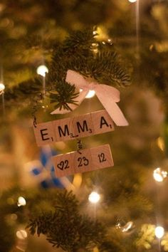 DIY Baby Craft Ideas - First Christmas Ornament made from Scrabble Letters and blanks with the date painted on it and ribbon.  Simple and cute.