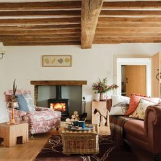 We love the look of this cosy, country living room. There's nothing better than a nice, warm fire roaring away and some spicy citrus scent flickering away to set the mood.