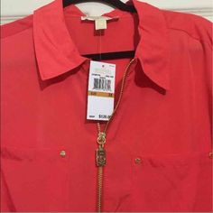 MK women's shirt-NWT New with tags!  Beautiful tailored details Bought and never wore. Perfect for spring/summer. Light and colorful.  Original tags attached.  Zips down middle Michael Kors Tops Blouses