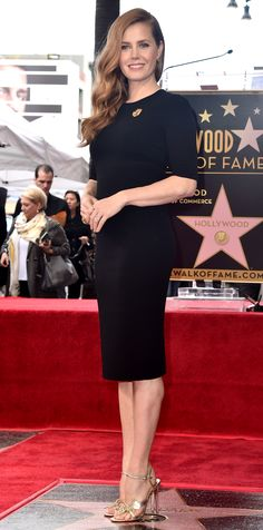Amy Adams was honored with a star on the Hollywood Walk of Fame, and she chose a sleek black Giorgio Armani sheath, complete with a gold pin and metallic Louboutin sandals, for the momentous occasion.