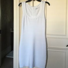 Bodycon dress White dress perfect for that all white party. Worn only once for engagement party at my house so never worn outside Calvin Klein Dresses Mini