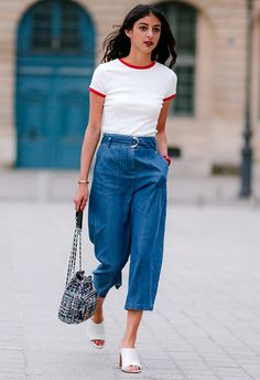 Go for a mash-up of comfy and cool, making the 70s your point of reference with a simple white tee (note the contrast trim) tucked into cropped, high-waisted denim. Add white, low-heeled mules to amp up the style vibes and finish with a tweed backpack for major faux vintage vibes