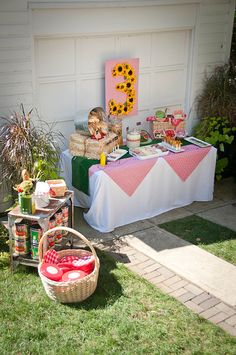 Adorable picnic themed birthday party. Love the sunflower 3