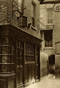 The Mitre Tavern, between Hatton Garden and Ely Place. It bears a stone mitre carved on the front with the date Ely Place still has its own Watchman who closes the gates a ten o'clock and cries the hours through the night. Victorian London, Vintage London, Old London, Victorian Era, London Places, London Pubs, London City, Hatton Garden, Old Pub