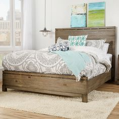 Mercury Row Seleukos Panel Bed from Wayfair Effortlessly anchor your master suite or guest room with this understated panel bed, featuring a simply chic design with woodgrain details.