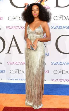 Solange shimmers in a pewter, custom-made Calvin Klein Collection dress.